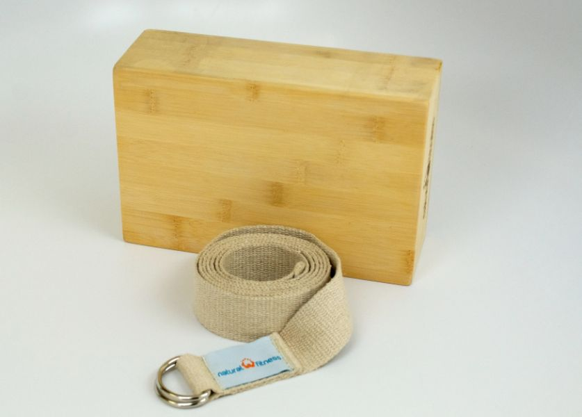 Natural Fitness Bamboo Yoga Block and Hemp Strap Kit is made from bamboo and hemp materials. These yoga accessories come in recycled packaging. Zero Impact Program funds the planting of a tree for each item sold.