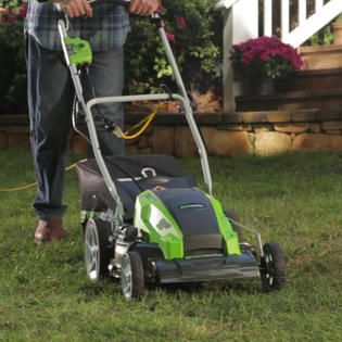 Man using a corded lawn mower