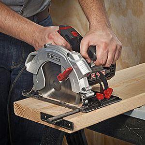 Sidewinder circular saw cutting through lumber