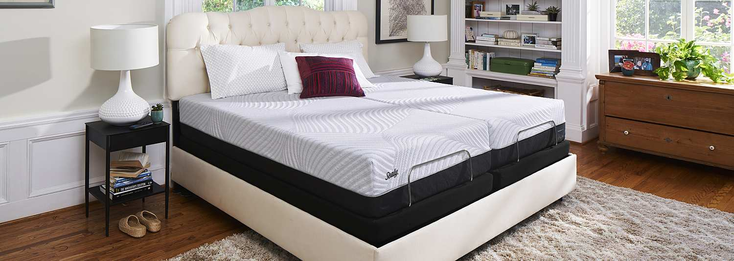 Unmade Sealy Mattress in Bedroom