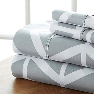 Sheets Stacked Beside a Window