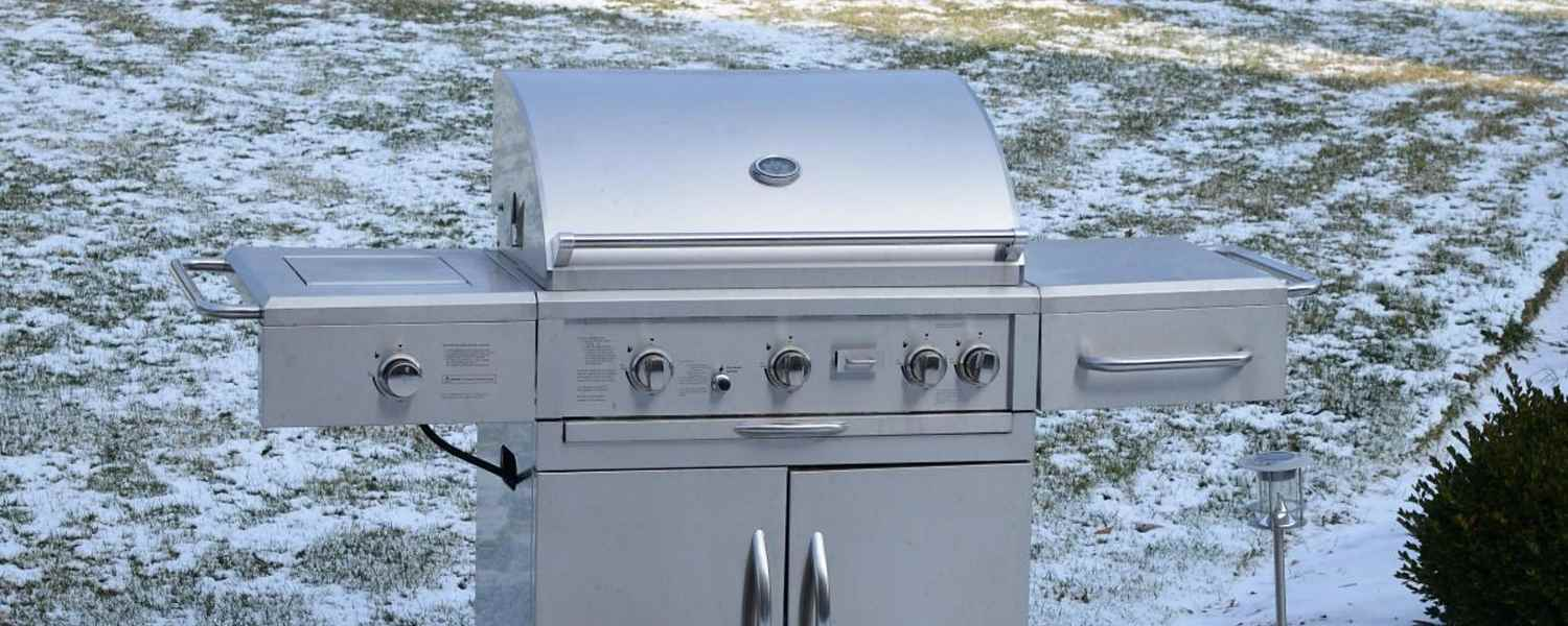 Grill in front of snow lawn