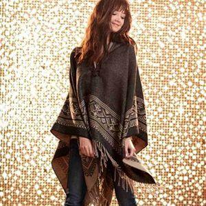 Woman wearing fashion poncho