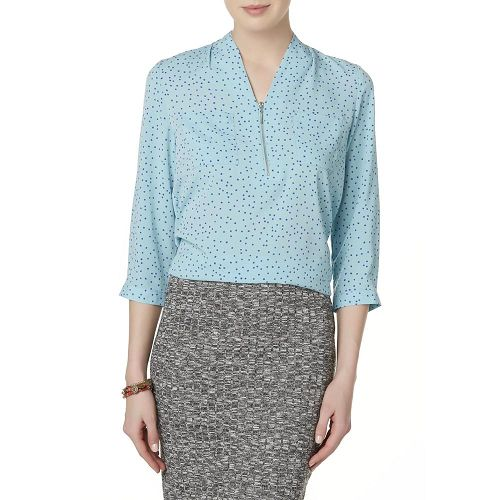 Woman in a Jaclyn Smith Women's Dotted Utility Blouse