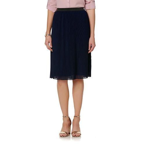 Woman in a Jaclyn Smith Women's Pleated Skirt