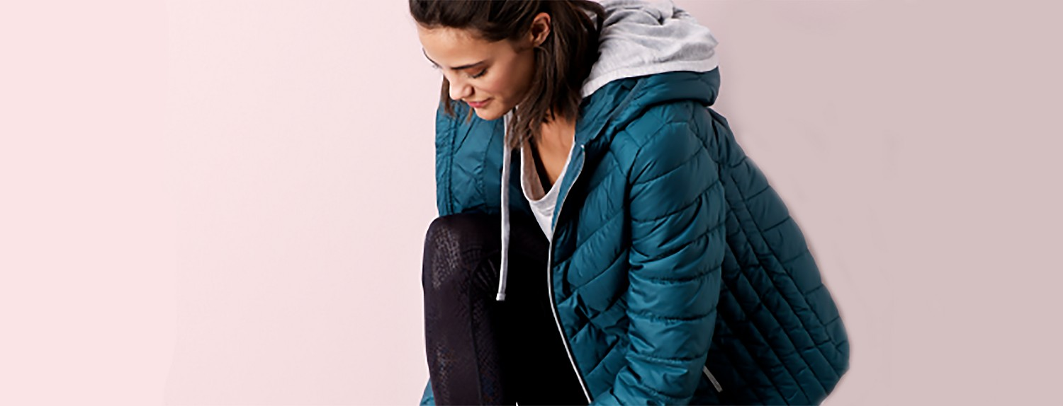 Woman in activewear and jacket