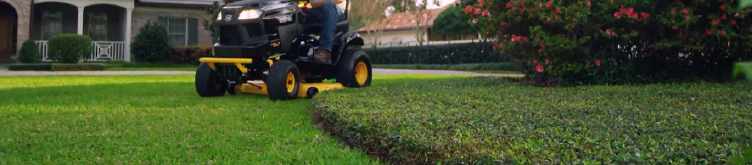 Cutting the lawn with a Craftsman riding mower