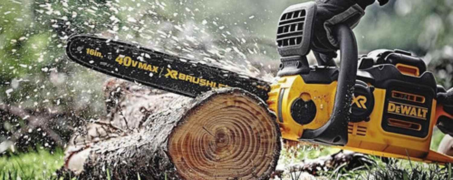 Chain saw cutting through a log