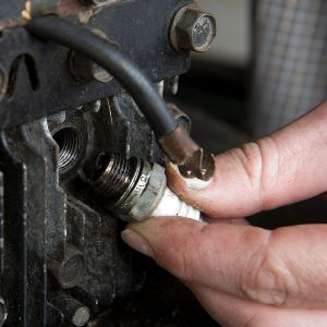 Removing the spark plug from riding mower