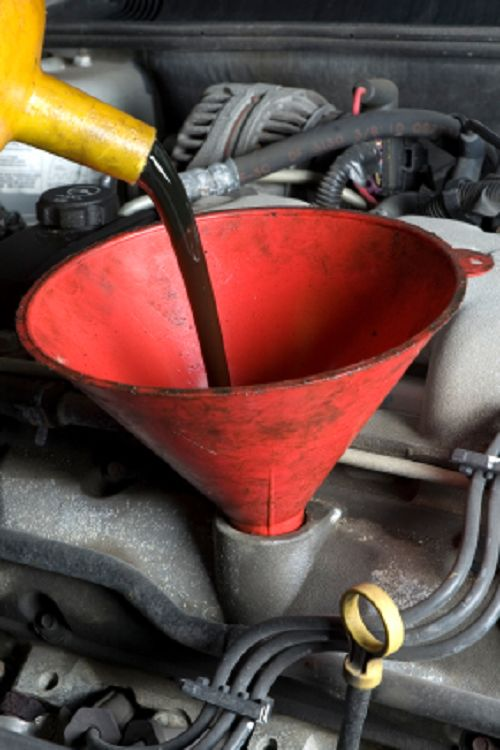 Adding oil to a mower