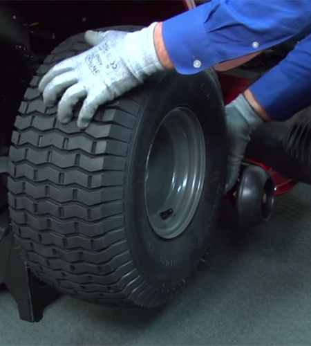 Removing a tire from a riding mower