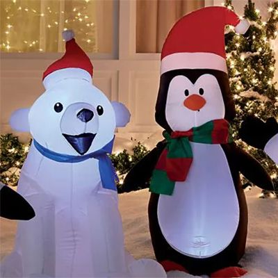 Polar bear and penguin inflatables on a lawn