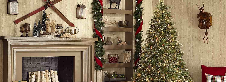 Christmas tree next to a fireplace