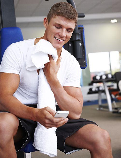 Man sitting on a weight machine