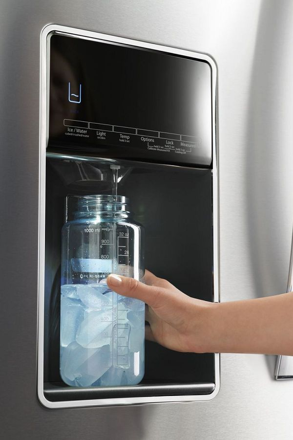 Person filling water bottle from refrigerator