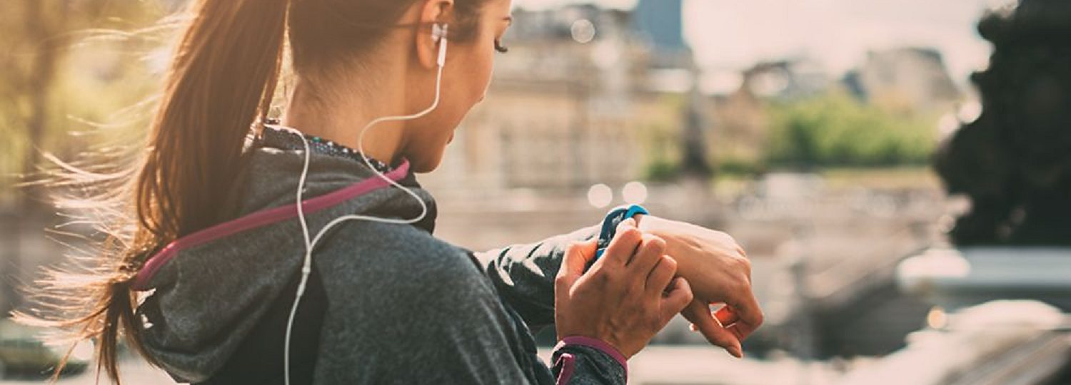Woman using her fitness tracker during a run