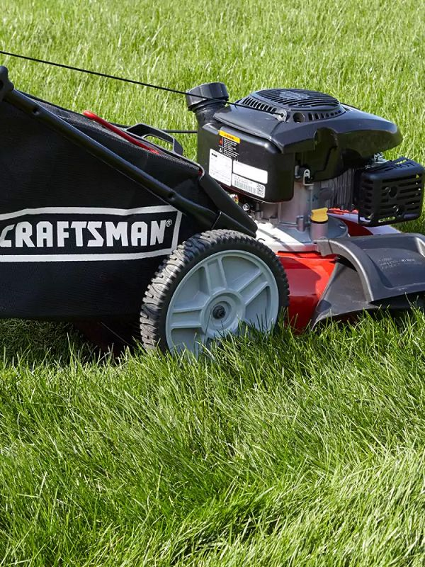 Lawn mower balanced on ground