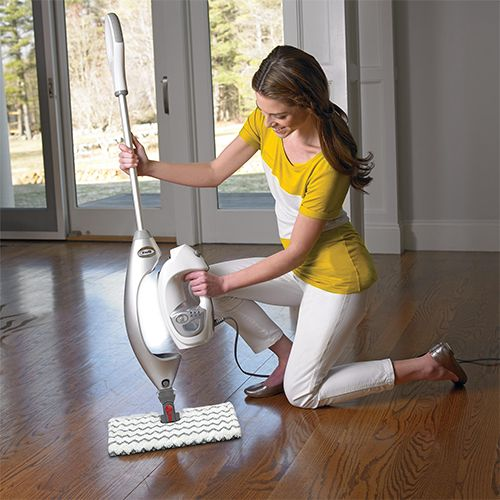 Woman placing tank into a steam mop