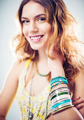 Woman wearing stacked bracelets