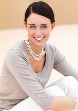 Woman wearing layered pearl necklaces