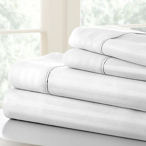 Stack of bed sheets and pillowcases