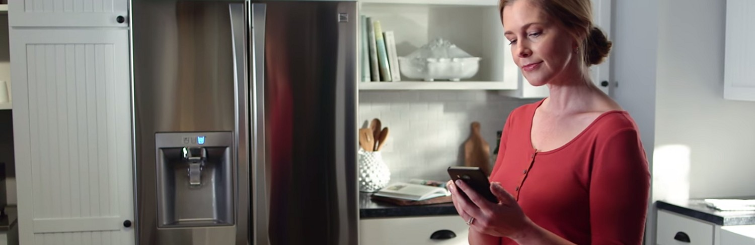 Woman using a Kenmore smart appliance