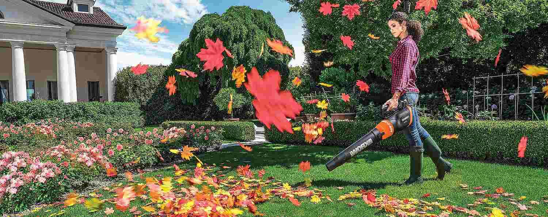 Woman using a leaf blower