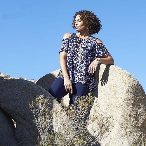 Woman in elegant Jaclyn Smith top