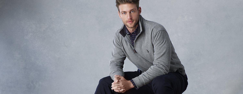 Man in a quarter-zip sweater