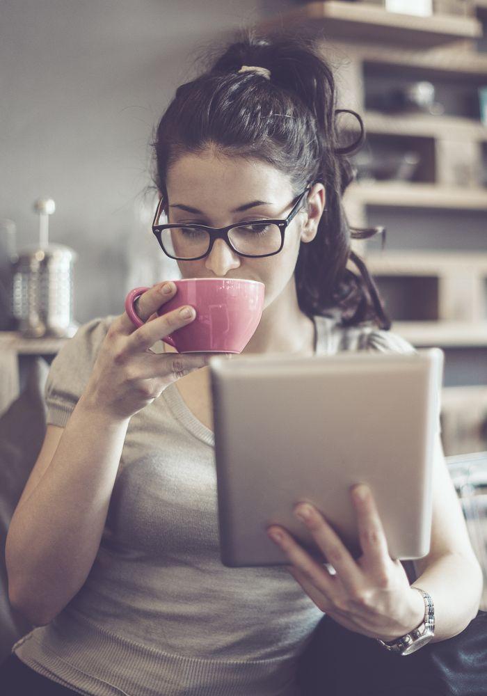 Woman reading book on an e-reader