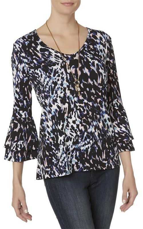 Woman in Jaclyn Smith Animal Print Bell Sleeve Shirt