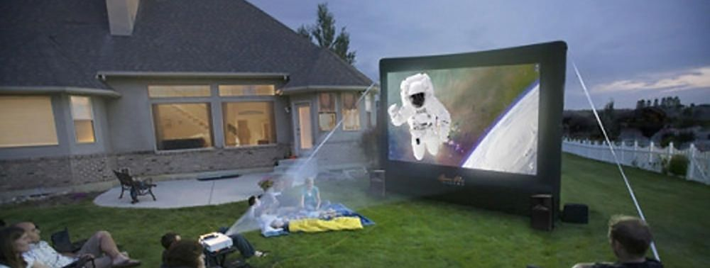 Family Watching Movie Outside