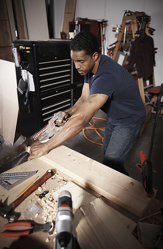 Man with a hand saw
