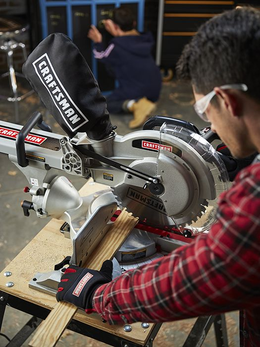 Man operating a Craftsman table saw
