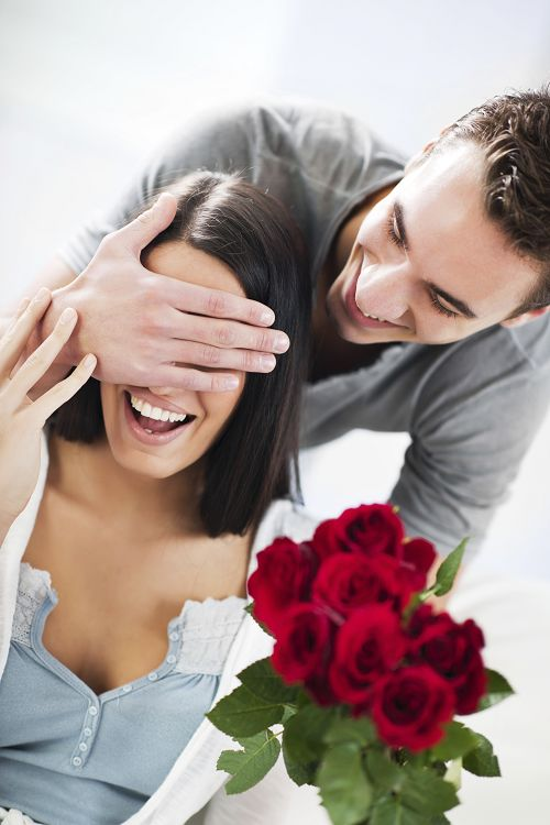 Man surprising partner with flowers
