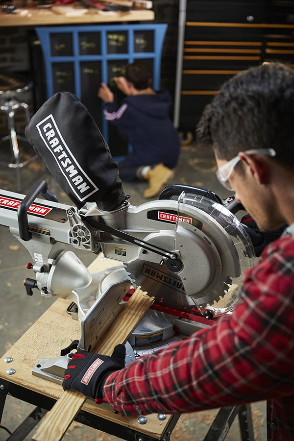 Man using a Craftsman table saw