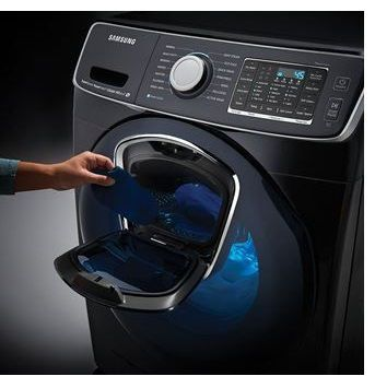 Person Interacting With Front Loading Washer