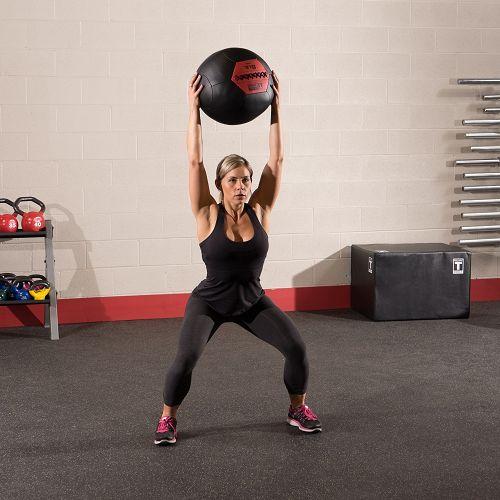 Woman lifting a medicine ball