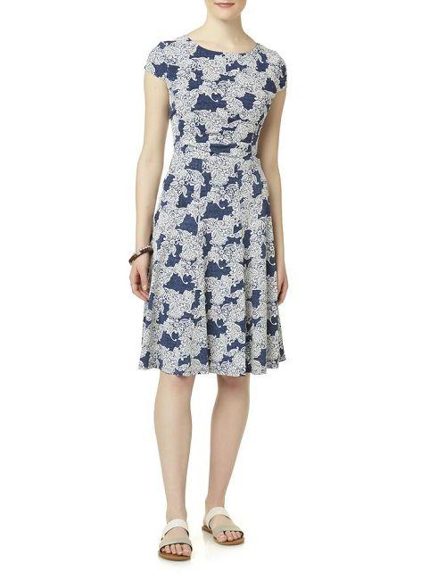 Woman in a Sandra Darren Puff-Print Shift Dress
