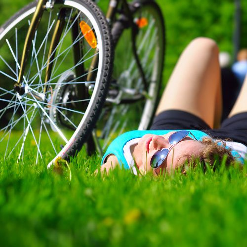 Woman laying near a bike