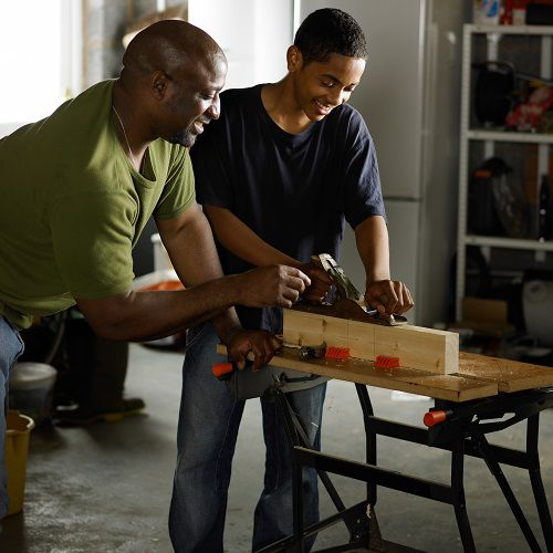 Dad and son working on a project