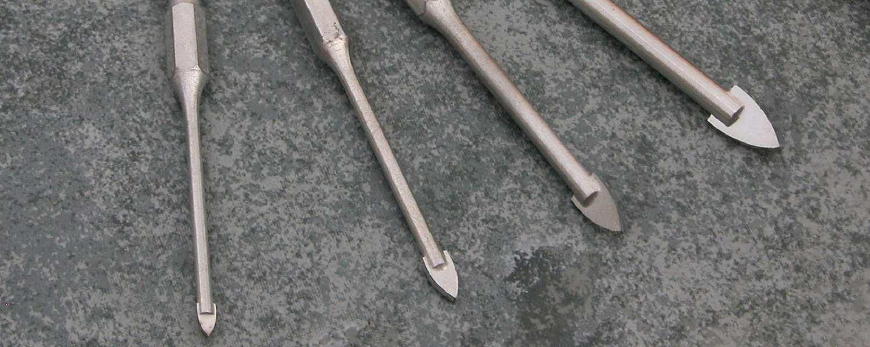 Tungsten carbide drill bits