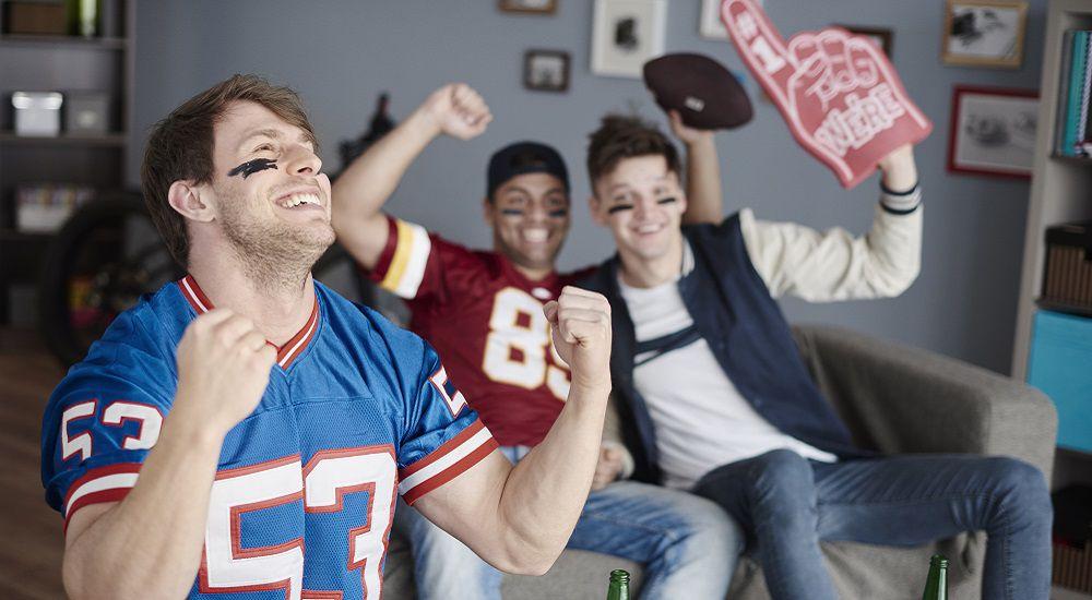 Guys wearing football jerseys