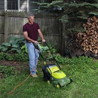 Man using corded electric mower