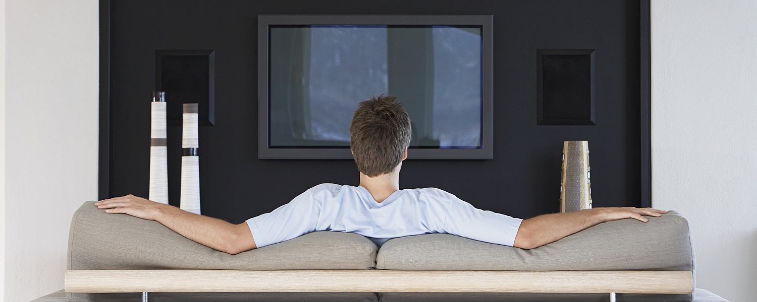 Man relaxing on the couch in front of the TV